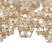 5mm Forget-Me-Not Spacers Transparent Glass with a Gold Wash