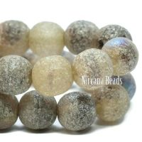 6mm Round Druk Ivory with An Antique Silver, AB, and Etched Finish