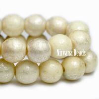 6mm Round Druk Yellow Ivory with Mercury Finish
