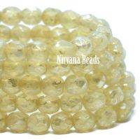 4mm Faceted Round Firepolished Bead Yellow ivory with a metallic picasso finish