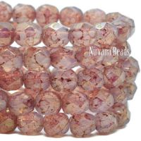 6mm Faceted Round Firepolished Bead Pink with a Pink Picasso Finish and a Gold Luster